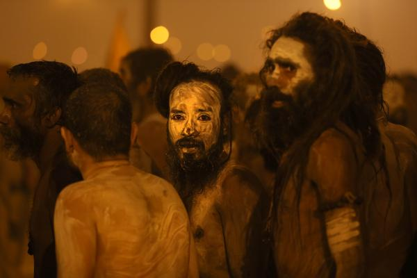 Naga Sadhus return after a dip in the holy waters.