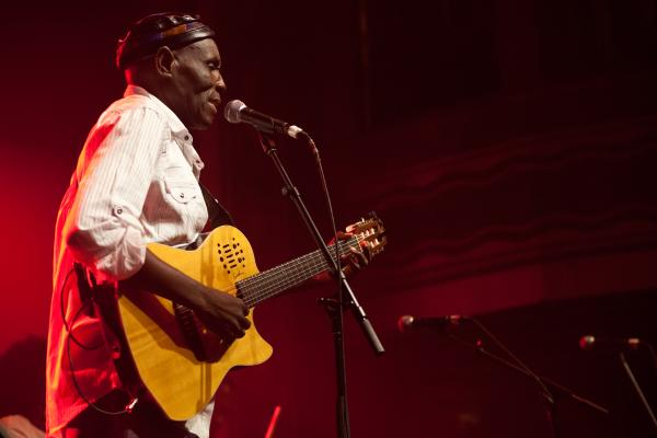 "Oliver Mtukudzi's sound of Afro-pop is well known as ""Tuku music.""  He's released more than 60 albums. He was accompanied at his performance this year by his band, The Black Spirits."