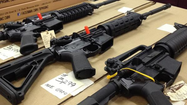 Rifles are displayed at a gun show in Marietta, Ga., on Dec. 22, 2012. A new poll shows overwhelming and bipartisan support for requiring criminal background checks before the sale of firearms at gun shows, as is already required before store sales.