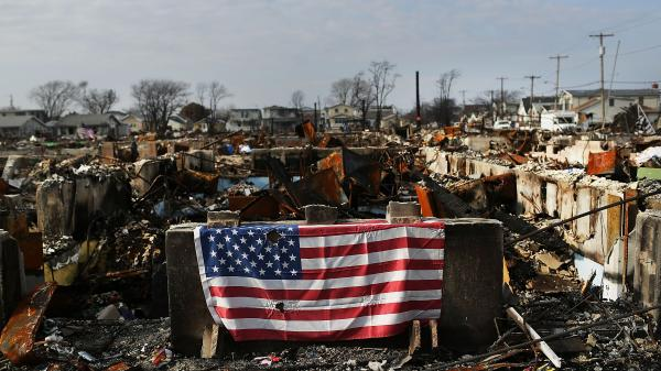 A U.S. flag still hung on the remains of homes in the Breezy Point neighborhood of Queens, N.Y., in December, nearly two months after Superstorm Sandy tore through the area.