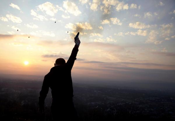 At sunset in the outskirts of Grozny, Kazbek Mutsaev, 29, fires celebratory gunshots as part of an age-old wedding tradition in Chechnya.