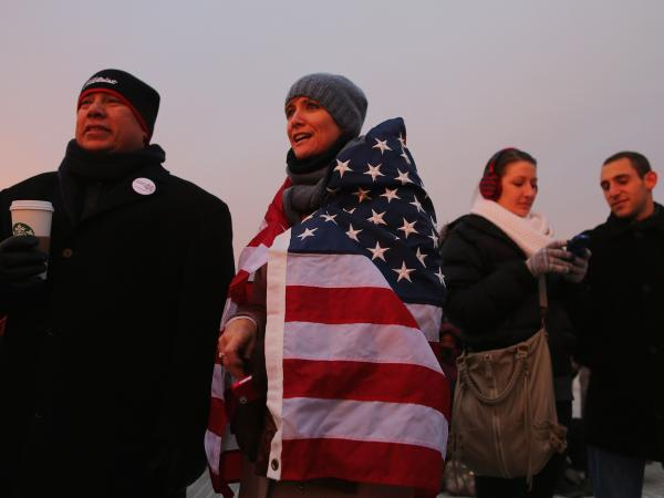 People gather near the U.S. Capitol for the inauguration ceremony on Monday.