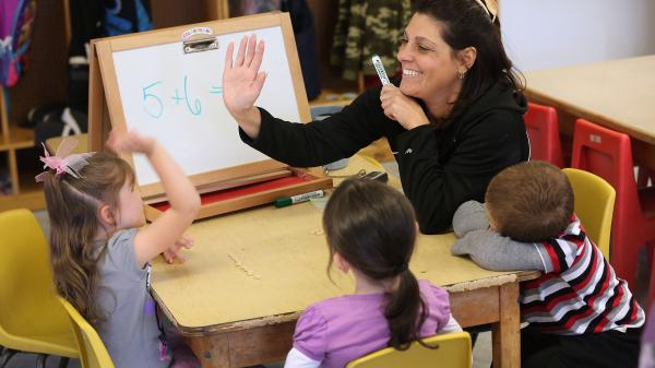Teacher Denise Severing leads a math lesson at a Head Start school in Woodbourne, New York.