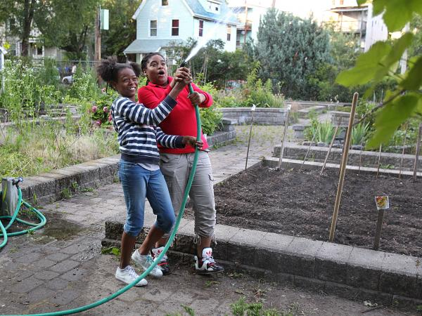 Best friends Kaori Tate and Ghiyahna Ennis explore their plot in the community garden.