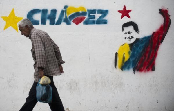 A man walks past a mural of Venezuelan President Hugo Chavez in Caracas, on Jan. 11.