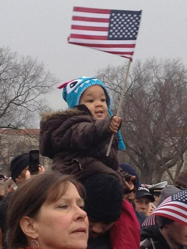 """Standing among the crowd at the inaugural parade, <em>All Things Considered</em> Host Melissa Block snapped this photo of two-year-old Taniya Washington hoisted on her uncle's shoulders with an American flag. According to Block's tweet, Taniya's uncle told his nieces, """"Y'all's next! You guys are the future!"""""""
