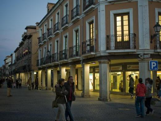 The Catholic Church owns more than just places of worship. It also owns apartments and retail buildings. Here, arcades line the busy Calle Mayor (Main Street) in Alcala de Henares, Spain, in 2008.