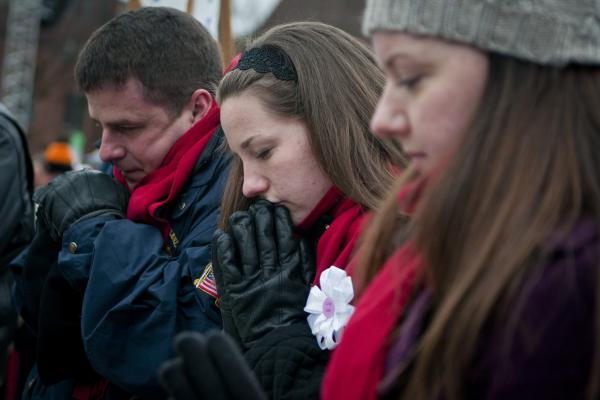 Participants silently pray at the March for Life rally.