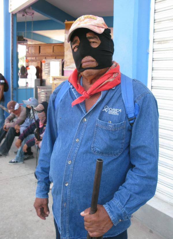 A man who identifies himself as a lower commander in Ayutla's self-defense brigade says residents had no choice but to take up arms.