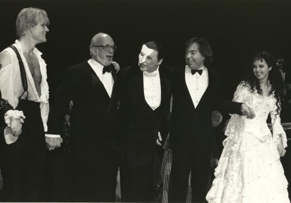 Opening night curtain call, Jan. 26, 1988, features Steve Barton  (Raoul), Harold Prince, Michael Crawford (The Phantom), Andrew Lloyd Webber and Sarah Brightman (Christine).