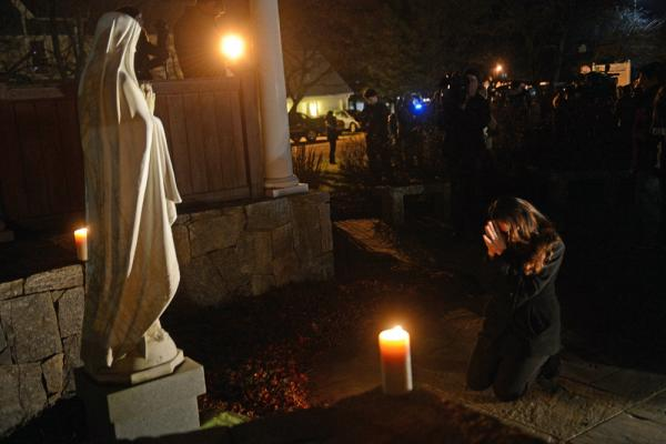 This photograph of Aline Marie praying outside St. Rose of Lima church in Newtown, Conn., has become the focus of a conversation surrounding ethics and photography.