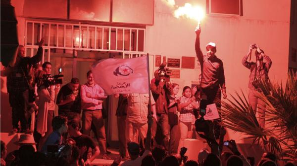 <p>Supporters of the moderate Islamist party Ennahda celebrate Tuesday after the party received the most votes to form an assembly that will write a new constitution. Tunisia was the first Arab country to stage a revolution this year, and the first to hold elections. </p>