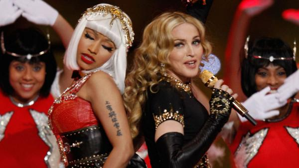 Nicki Minaj (left) and Madonna perform during the halftime show at the Super Bowl in February. In a song from Madonna's new album, <em>MDNA,</em> the two singers each play with traditionally feminine and masculine gender roles.