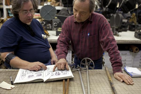 Jim Elyea (left) and shop manager Gary Aardahl look over examples of infantry equipment fielded by the major world powers in World War I and World War II. They are researching Spanish military equipment from 1936 to 1939 for an upcoming HBO show about Ernest Hemingway.