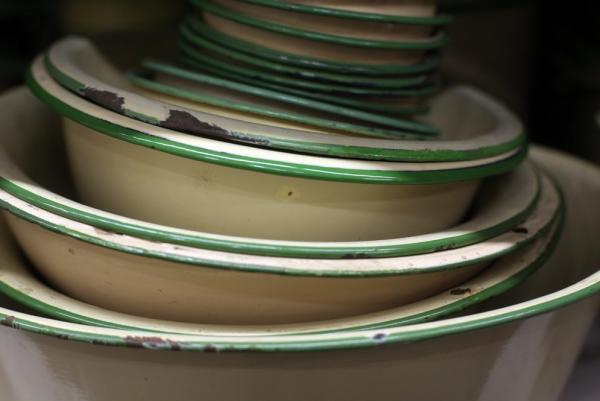 "Beige and green stacked bowls — made in the 1920s — are among the most popular items at History for Hire, because they quickly convey the feel of the 1920s and '30s. ""Put a stack of them in the sink or on the table, and most people know they are looking into an earlier time period,"" Elyea says."