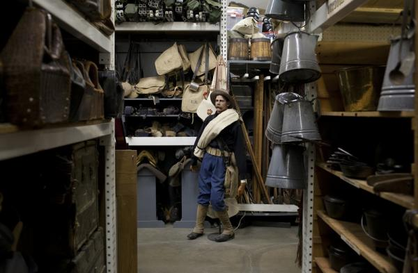 A mannequin dressed in Spanish-American war gear stands at the end of one of the aisles in the military-outfitting section of History for Hire.  While the prop house doesn't carry uniforms, it does carry plenty of the equipment and leather gear.  The coffee pots in the foreground were used in  <i>Tombstone</i> and <i>Wyatt Earp</i>.