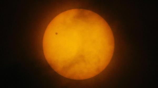 Venus passes between Earth and the sun during its last transit on June 8, 2004, as seen from Manila, Philippines. The next transit of Venus will be in 2117.