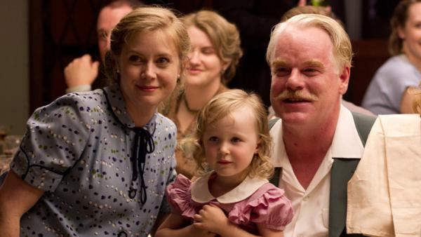 "In Paul Thomas Anderson's <em>The Master,</em> Amy Adams plays Peggy Dodd, the spouse of a charismatic spiritual leader, played by Philip Seymour Hoffman. Adams says her character is smart and educated but feels ""more powerful behind a man than in front of a man."""
