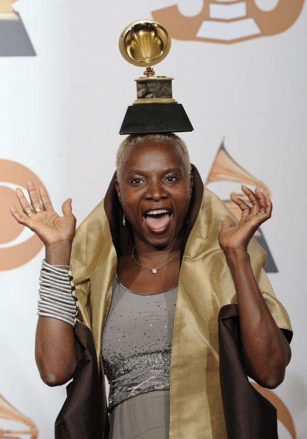 "Angelique Kidjo is seen with her award for best contemporary world music album for ""Djin Djin"" at the 50th Annual Grammy Awards on Feb. 10, 2008, in Los Angeles."