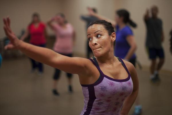 Melissa Colon dances in a zumba class at the Robert Guevara Community Center in Kissimmee.