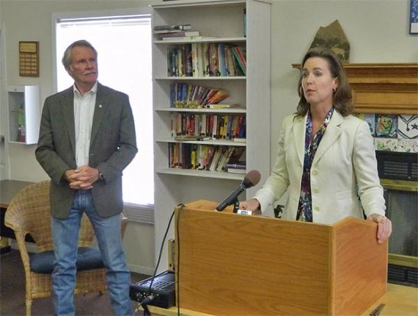 Oregon Governor John Kitzhaber looks on as First Lady Cylvia Hayes speaks as a daycare center in Bend. Photo by Chris Lehman
