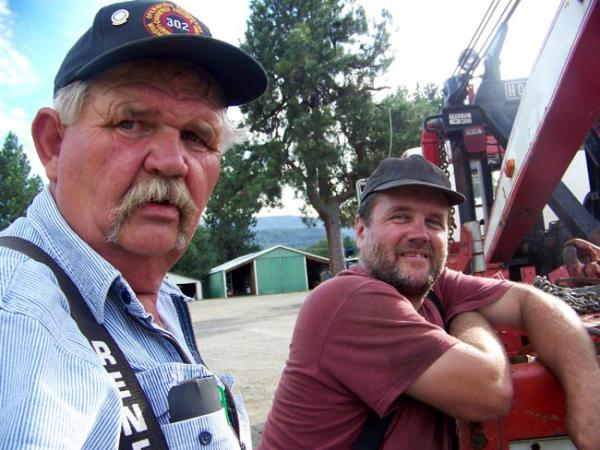 Dave Johnston (left) nearly lost his rural home near Ellensburg, Washington in the Taylor Bridge Fire. Photo by Anna King