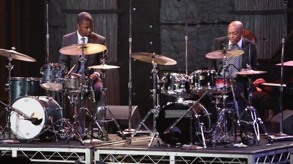 Marcus Gilmore (left) and Roy Haynes perform together in Washington, D.C., in 2009. Haynes' daughter is Gilmore's mother.