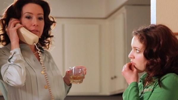 Donna (Molly Parker) is the drunk, distracted matriarch to Maggie (Olivia Harris) and her nervous siblings in <em>The Playroom</em>.