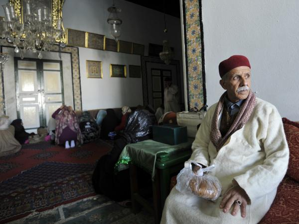 A Sufi man sits during his visit to a shrine in Tunis. Tunisia's government has promised emergency measures to protect Sufi Muslim mausoleums, which have been targeted by radical Islamist groups.