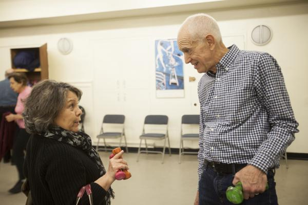 John David, 73, chats with one of his students after his exercise class at the 92nd St Y in New York.