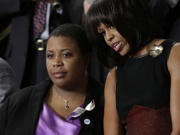 First lady Michelle Obama stands with Cleopatra Cowley-Pendleton, whose daughter was recently shot and killed in Chicago, at the State of the Union address.