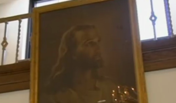 The Jesus portrait that hangs inside an Ohio middle school.