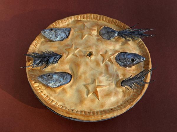 Stargazy Pie, a cornish dish named for the way the fish heads poke through the crust towards the sky.