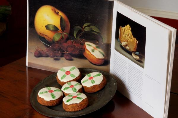 Cakes displayed with a reproduction of Raphaelle Peale's <em>Still Life with Cake</em>, from circa 1822.