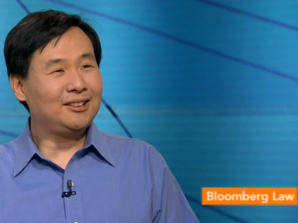 Screen shot of <em>Ask Me Another </em>Puzzle Guru Art Chung on Bloomberg TV.