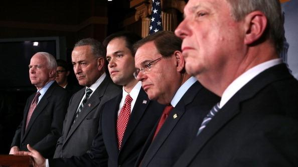 Sen. Charles Schumer, D-N.Y. and Sen. Marco Rubio, R-Fla., (second and third from left) announced plans to work on a bipartisan immigration proposal with their colleagues on Jan. 28 on Capitol Hill. They were also some of the first to respond to a leaked White House proposal.