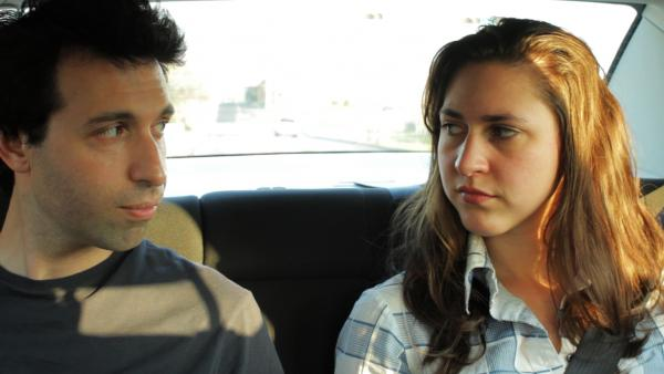 The deeply personal narrative that drives writer-director Alex Karpovsky's road trip comedy <em>Red Flag</em> even extends to his protagonist's name. (Pictured: Karpovsky and Caroline White)