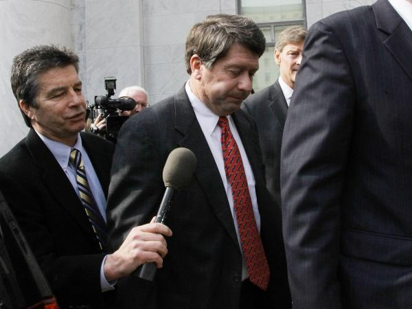 Stewart Parnell (center), former president of the now-defunct Peanut Corp. of America, is one of four executives indicted over a 2009 outbreak of salmonella.