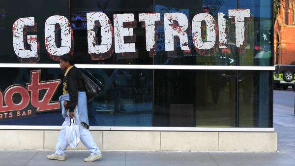 A pedestrian walks in downtown Detroit on Oct. 24, 2012.