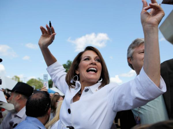 Republican presidential candidate Rep. Michele Bachmann (R-MN) encourages people to vote for her outside the Hilton Coliseum at Iowa State University on Saturday.