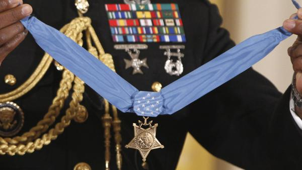 The Medal of Honor is held by a military honor guard at the White House last September, when President Obama awarded the medal to Marine Cpl. Dakota Meyer, 23, from Greensburg, Ky., for his actions in Afghanistan. The Supreme Court is now deciding if those who <em>falsely</em> claim to have won such military awards can be prosecuted for lying.