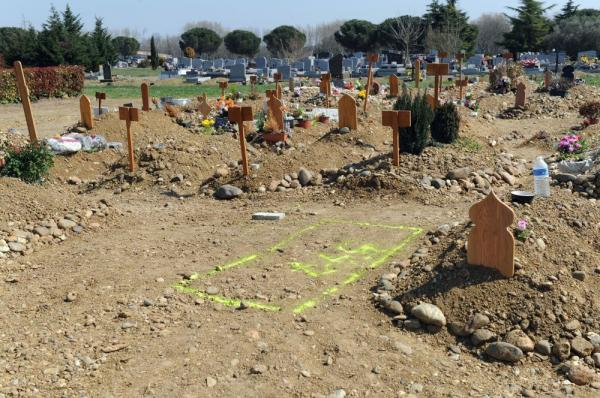 A sign on the ground marks the place for municipal workers to dig in Cornebarrieu cemetery, a Toulouse suburb in southwestern France.