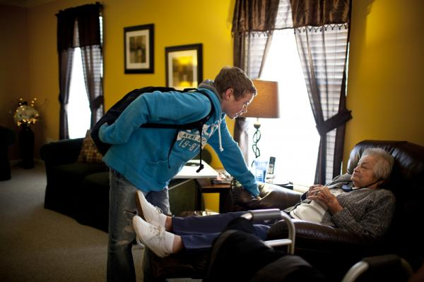 "Chris Martin, 14, greets his great-grandmother AnnaBelle Bowers, 87, who lives part time with the Martin family in Harrisburg, Pa. Occasionally, Chris stays at home to watch ""Snootzie,"" as the family affectionately calls her, when his parents are busy."