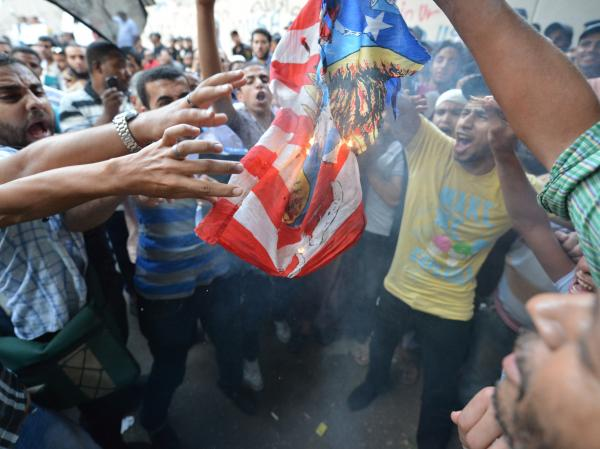 Egyptian protesters burn the US flag during a demonstration against a film deemed offensive to Islam on September 12, 2012 outside the US embassy in Cairo.