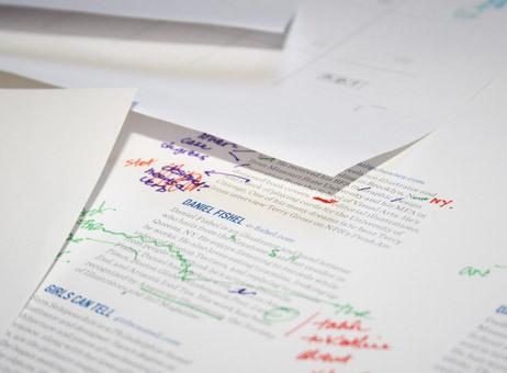 Each editor takes a different color pen and goes to town marking up the calendar's draft pages.