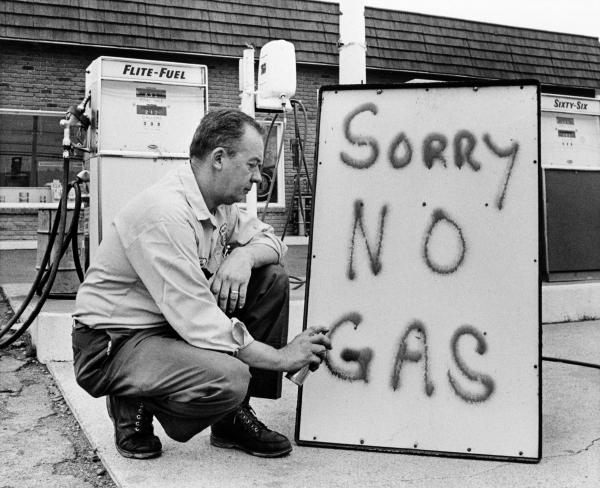 Leon Mill spray paints a sign outside his Phillips 66 station in Perkasie, Pa., on June 1, 1973, to let his customers know he's out of gas. An oil crisis was the culprit, squeezing U.S. businesses and consumers who were forced to line up at gas stations for hours.