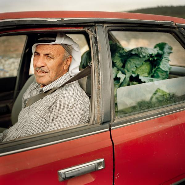 Jamil takes cabbages to the market in Bethlehem.