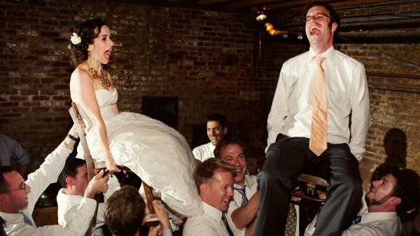 """Young newlyweds are serenaded with the strains of """"Hava Nagila."""" The unlikely origins of the popular Jewish standard are explored in Roberta Grossman's documentary feature <em>Hava Nagila: The Movie.</em>"""