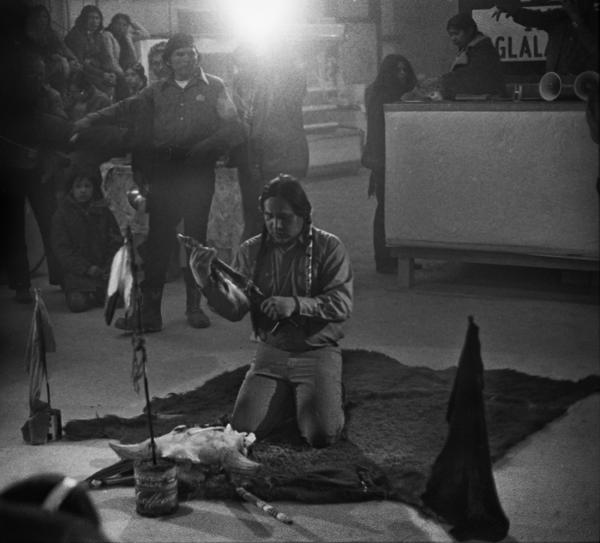 Leonard Crow Dog, spiritual leader of the American Indian Movement, prepares a chanupa (pipe) for prayers.