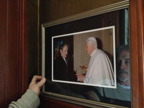 "Bernie McDaid keeps a framed photo of his meeting with Pope Benedict by his front door. ""It was a tough moment,"" McDaid says."